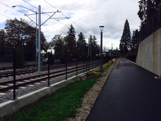 From here we follow the tracks separated by a narrow bed here planted with the Clover again. Mcloughlin lies just east of the tracks. I didn't clammer up to inspect the plantings to the right above the retaining wall.