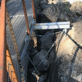 Building such a structure across was not straightforward. Posts required drilling into the largest rocks and relies heavily upon the bracing turnbuckle system seen here.